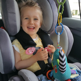 Aurora in her swivel car seat