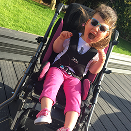Ella in her special needs Snappi Buggy