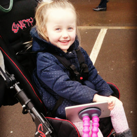 Millie in her Swifty buggy
