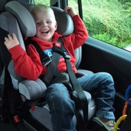 Theo in his special needs car seat
